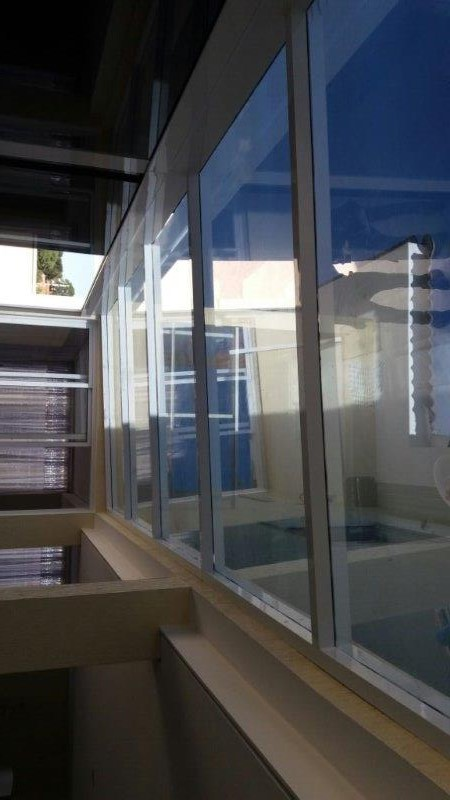 Pergolado com cobertura de vidro